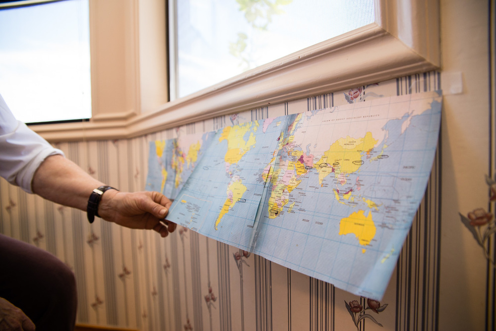 Taped to Bonnie's kitchen wall were three sections of a world map. They outlined future trips.
