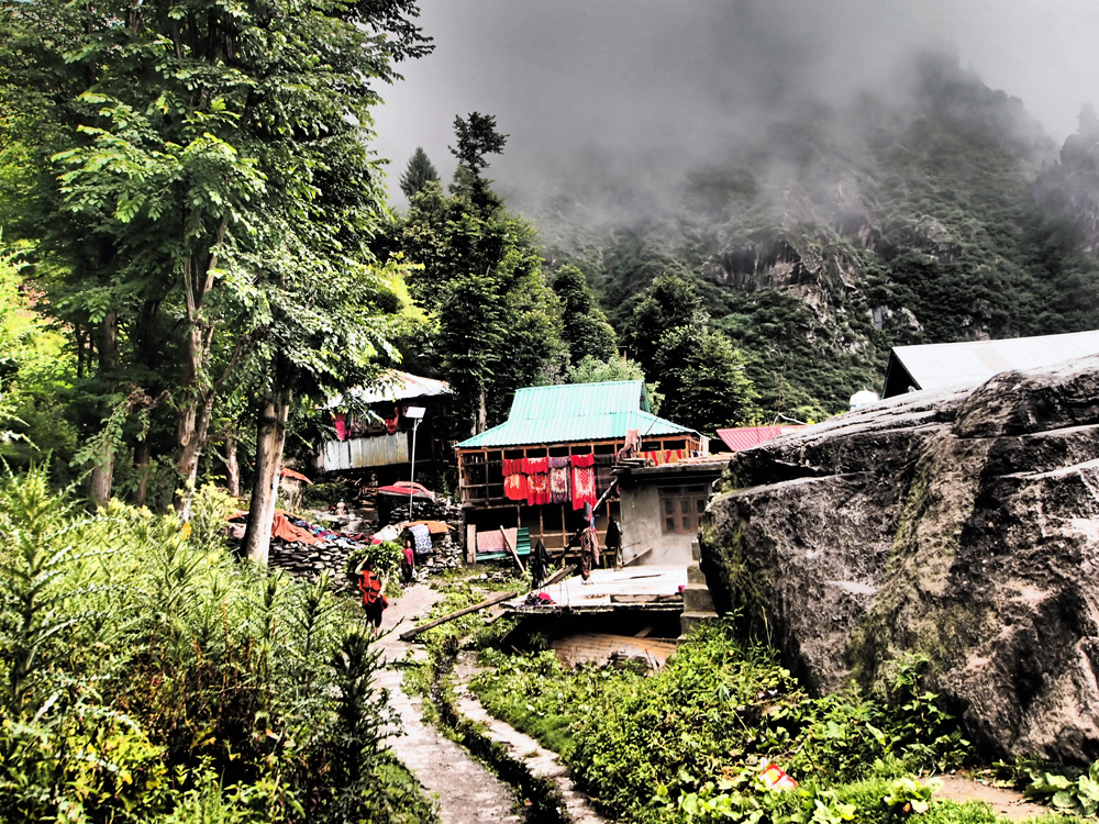 The isolated village of Malana practices an extreme form of untouchability - all outsiders are considered unclean, and touching anything in the village provokes a strictly-enforced Rs 2500 fine. Photographing scenes such as this is permitted, but photographing the carved wooden temples in the centre of the small town would also attract the fine.