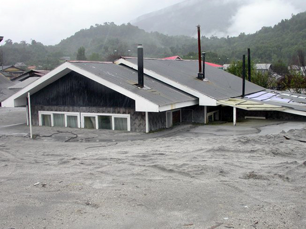 In 2010, a year after a volcanic eruption burried Chaiten, many buildings and houses still remained covered in ash.