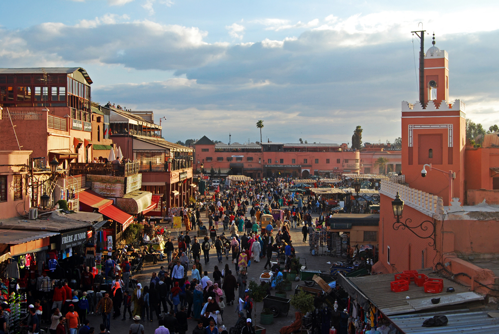 Jemaa el-Fnaa Square in Marrakech, Morocco, is the main square of the city and the meeting point of tourists, vendors, locals, and businesses. The urban language is in typical Moroccan style.