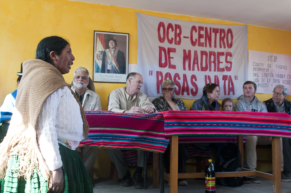 The president of the Weavers association in Calamarca welcomes visitors from Save the Children.