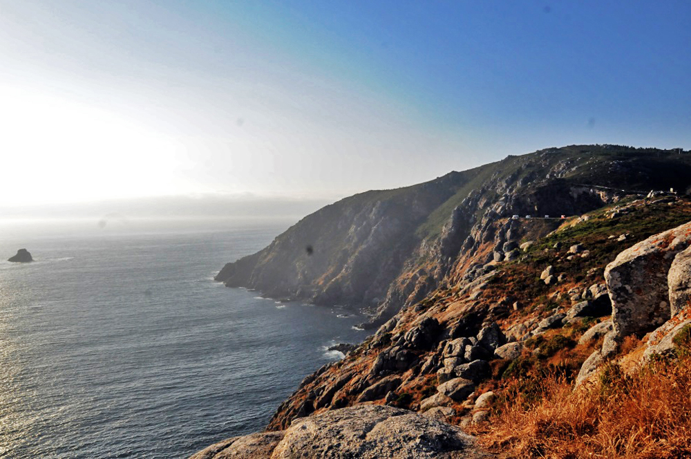 The cliffs at sunset at Finisterre, the end of the Camino, once considered the end of the earth.