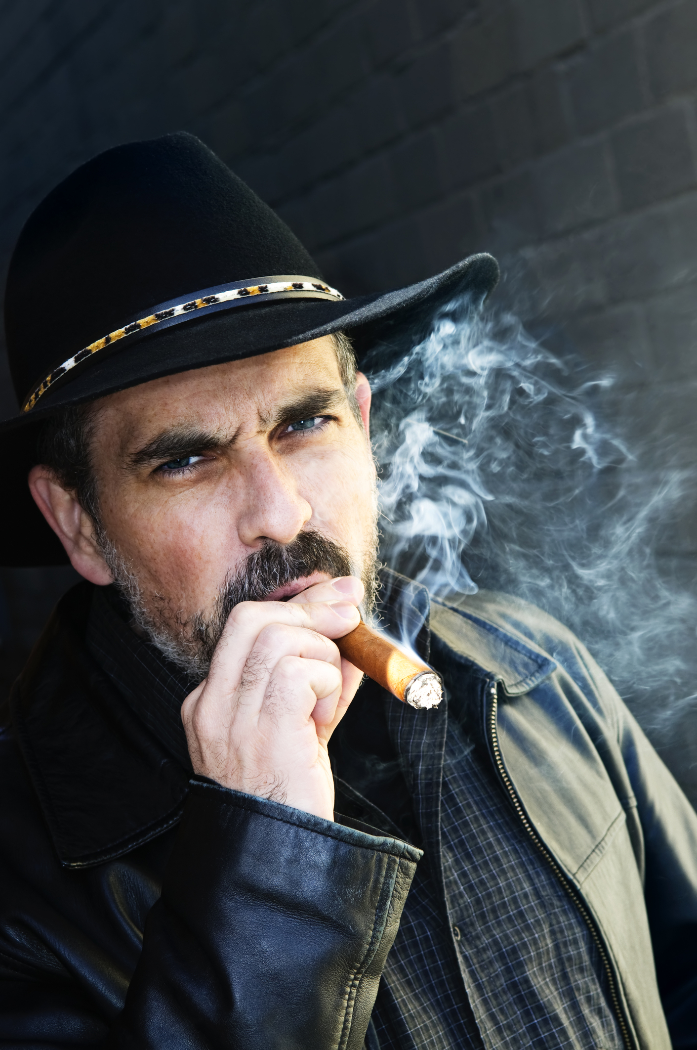 http://www.dreamstime.com/stock-photo-bearded-man-smoking-cigar-image11989340