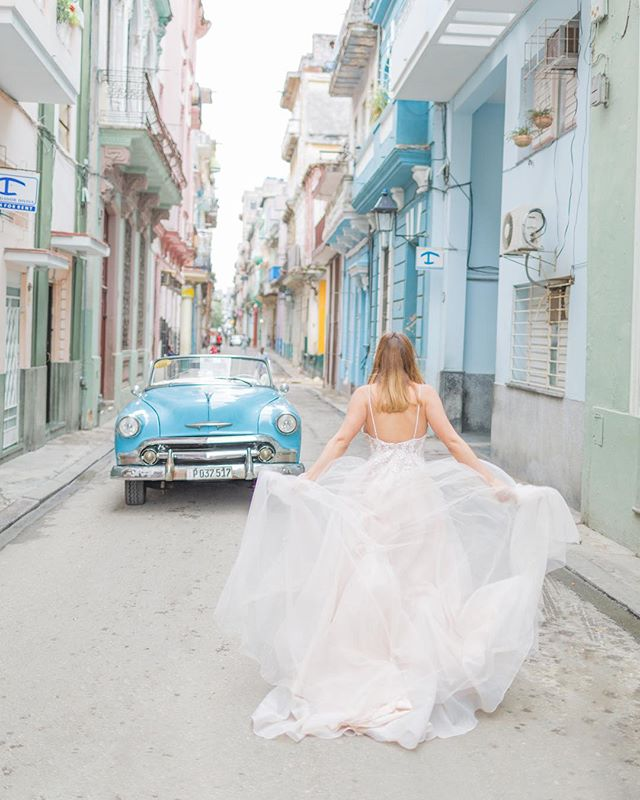 "It's hard to express how much I love this photo. I just adored working with Jeli & Ernesto in general but this photo in particular captured my heart. These newlyweds were dying for portraits in Old Havana and oh man did the city deliver! It's as if this @cathyebrada dress was made for her 💕The little secret behind why I love this image is that Jeli has a tattoo that reads ""she flys with her own wings"". Tell me this image doesn't look like she's an angel in flight?!"