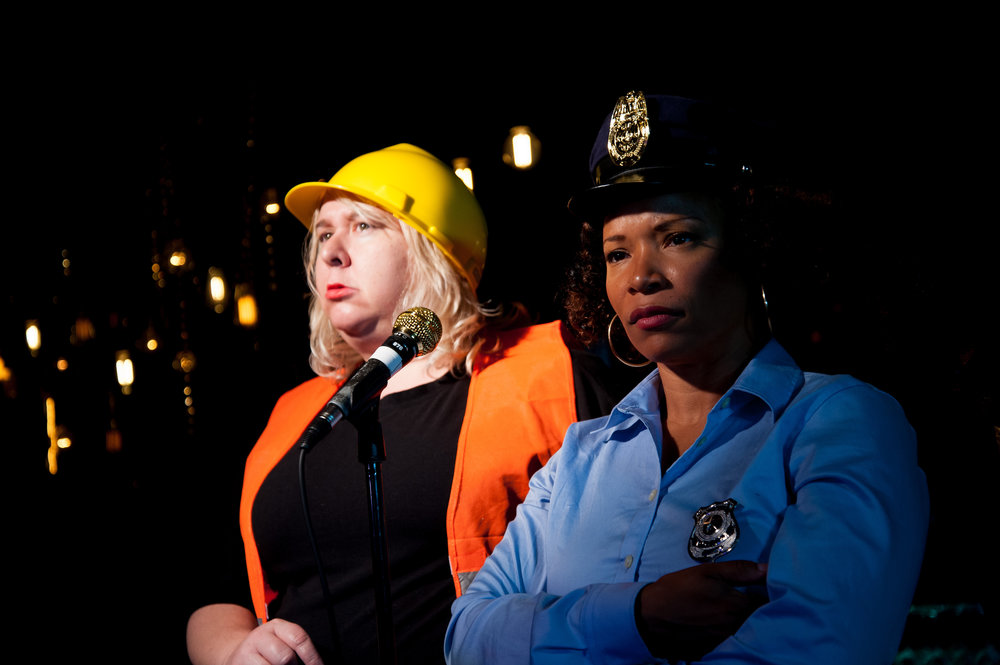 Jaime Moyer & LeShay Tomlinson as Construction Worker & Police Officer (2016)