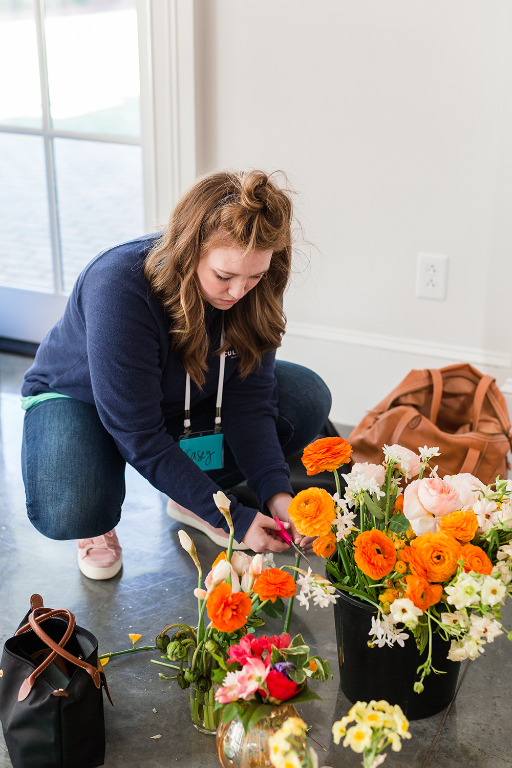Cultivate's designer,  Casey  working her magic with shoot florals.