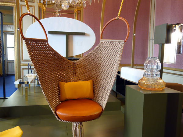 From the Louis Vuitton Objet Nomades collection, Swing Chair by Patricia Urquiola. Vase by Baccarat