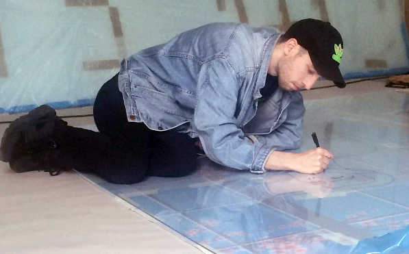 Artist Julien Ceccaldi making an artwork for the Biennale