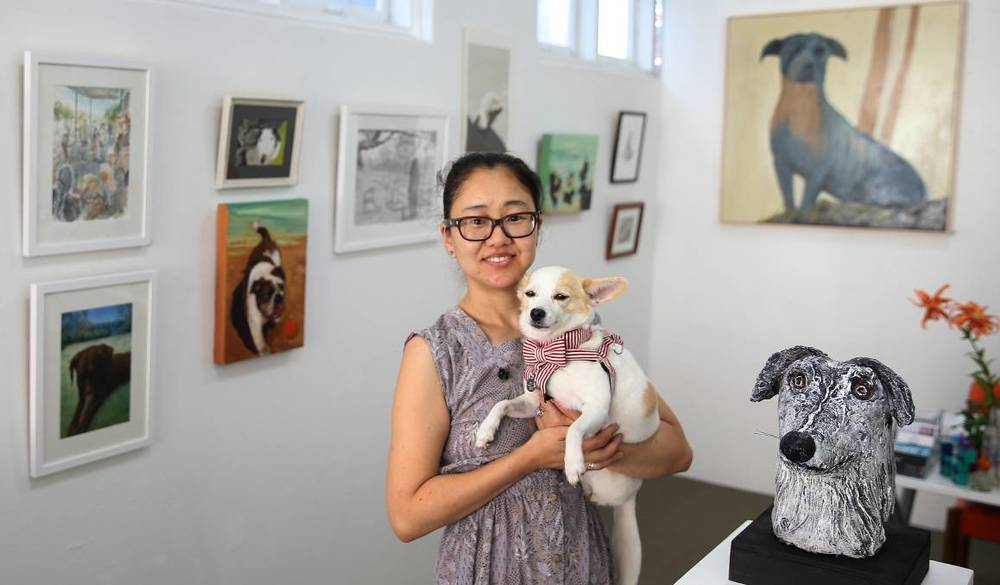 Top Dog: Ahn Wells and her dog Coco at Gallery 139 in Hamilton. Coco inspired the latest exhibition at the gallery, titled Dogs in ART. The exhibition features 61 works. Picture: Marina Neil.