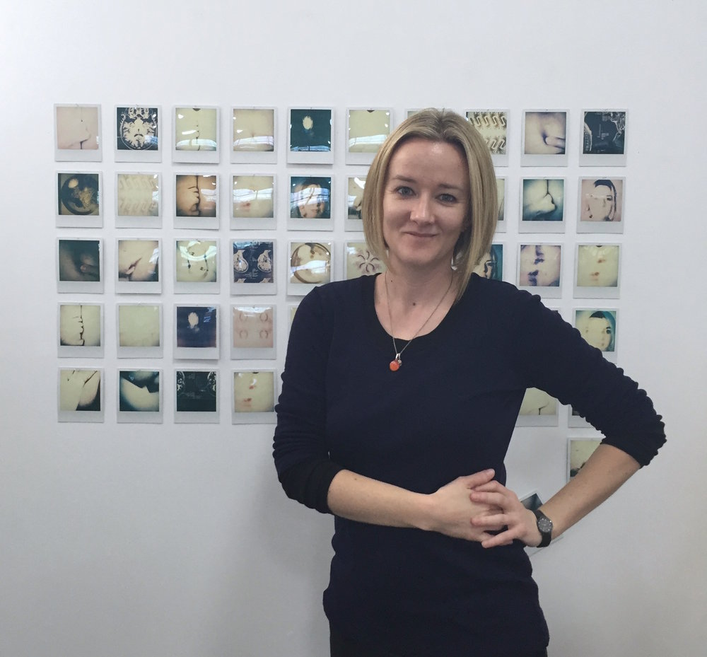 "Clare in front of the collaborative work by her and Maisie  Form  2016 colour Impossible Polaroid photographs in the exhibition ""The Artist as Mentor"" at Gallery 139 31 August - 17 September 2016"