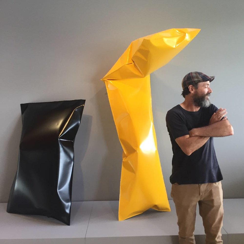 Braddon Snape with his sculptures at Lake Macquarie City Art Gallery during 2017