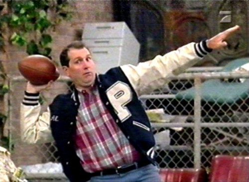 al-bundy-in-polk-high-letterman-jacket-with-football-jpg.jpg