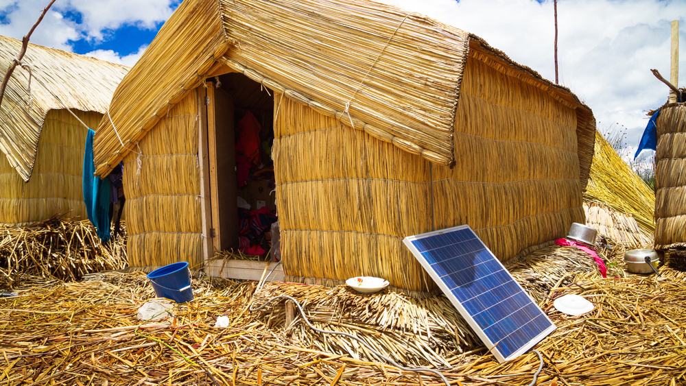 This solar panel doesn't generate enough power for Sumandy's washing machine, much less hospitals, factories & cities