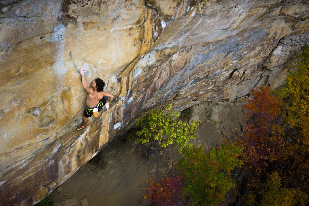 """The author about to discover just how measurable his slab skills are on the crux of """"Lord Voldemort"""" (5.14a), New River Gorge, West Virginia. Photo: Rachel Avallone"""