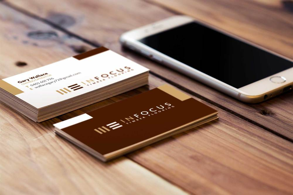 timber-flooring-business-card-iphone-in-focus