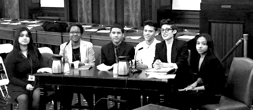 Students testify before the Department of Education