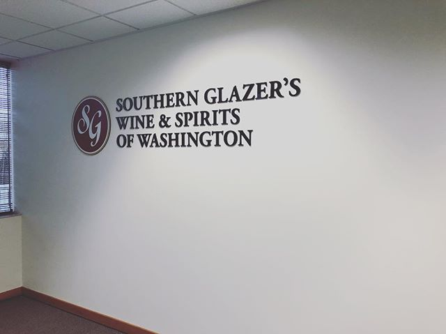 Dimensional lettering for our friends at @sgwinespirits here at their Puyallup warehouse. Black acrylic with a digital print logo on @3mfilms Clean and effective is the #SignDog way