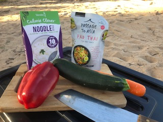 Just because you're camping doesn't mean you have to succumb to junk food. My veggies lasted outside of the esky for four days without turning. And supermarkets these days have some great options for quick prep meals.