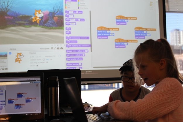 Children learning to control Scratch cat using Cartesian coordinates.