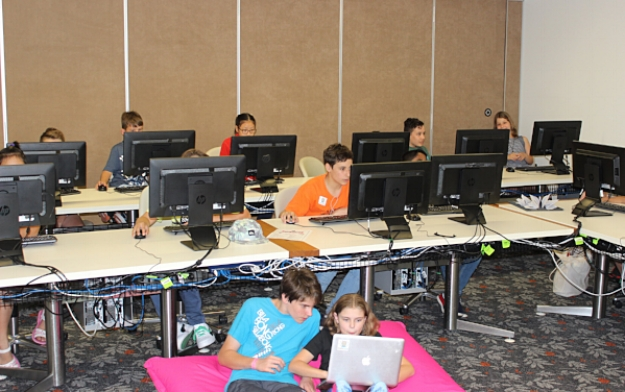 Children in full programming mode at the Fun Palace, State Library of Queensland
