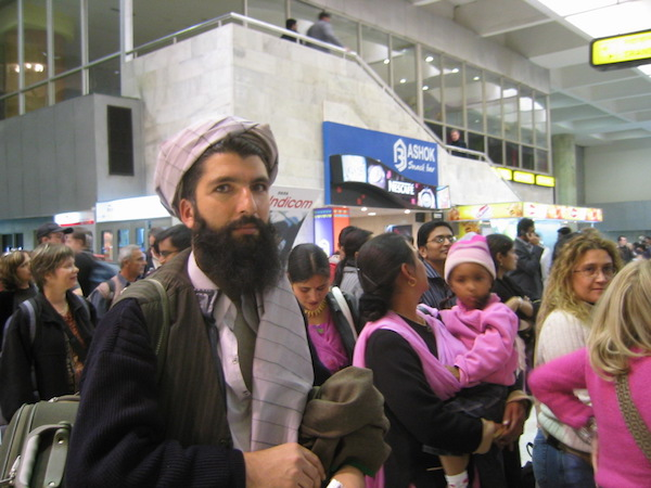 A beautiful Afghan man and a chaotic afternoon at the Delhi airport