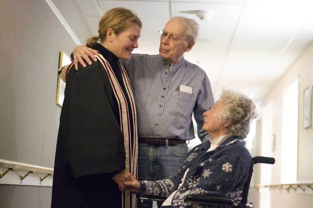 Once a month, Kirianne heads to Longview, an assisted living center in Ithaca, to provide a communion service. Here she comforts two residents.