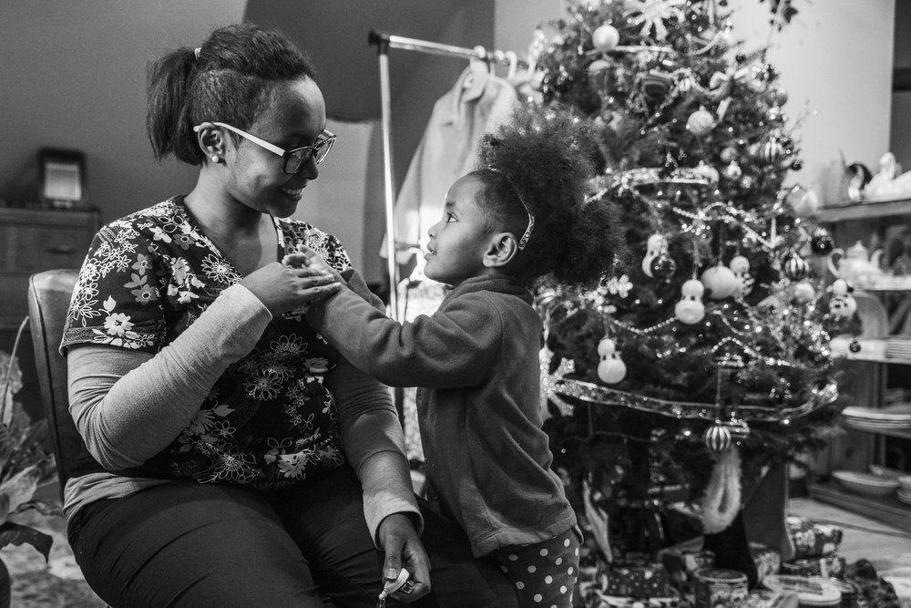 Dunia Hirsi shares a moment with her daughter, Maya, in their home decorated for Christmas. Hirsi no longer communicates with her family, who refused to speak with her after she decided to follow the Christian faith and no longer be Muslim.