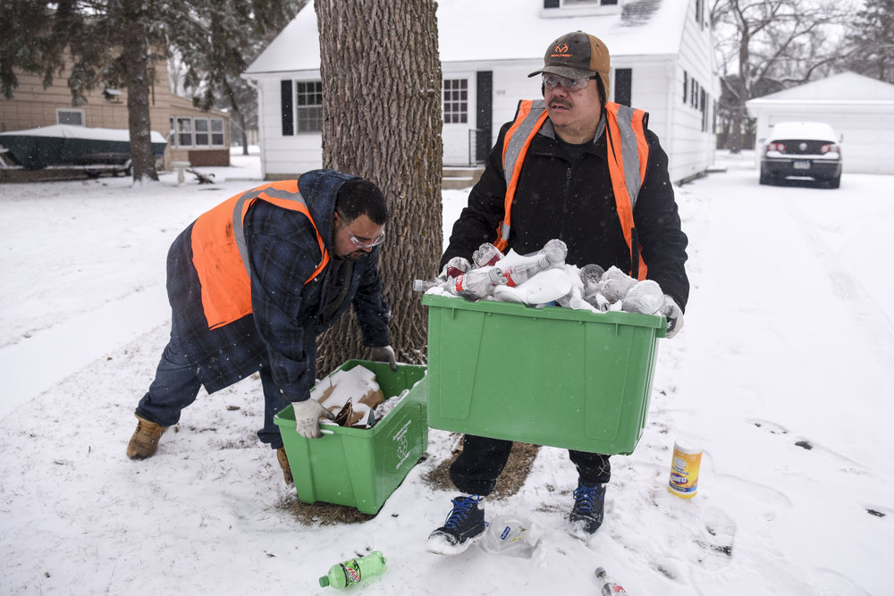 Martin Bravo, left, and Elijah Gomez pick up recycling during their volunteer hours. Curbside recycling pickup is the largest program run through Kandiyohi County Community Service and in 2017, the program had over two thousand houses that participated in curbside pickup.