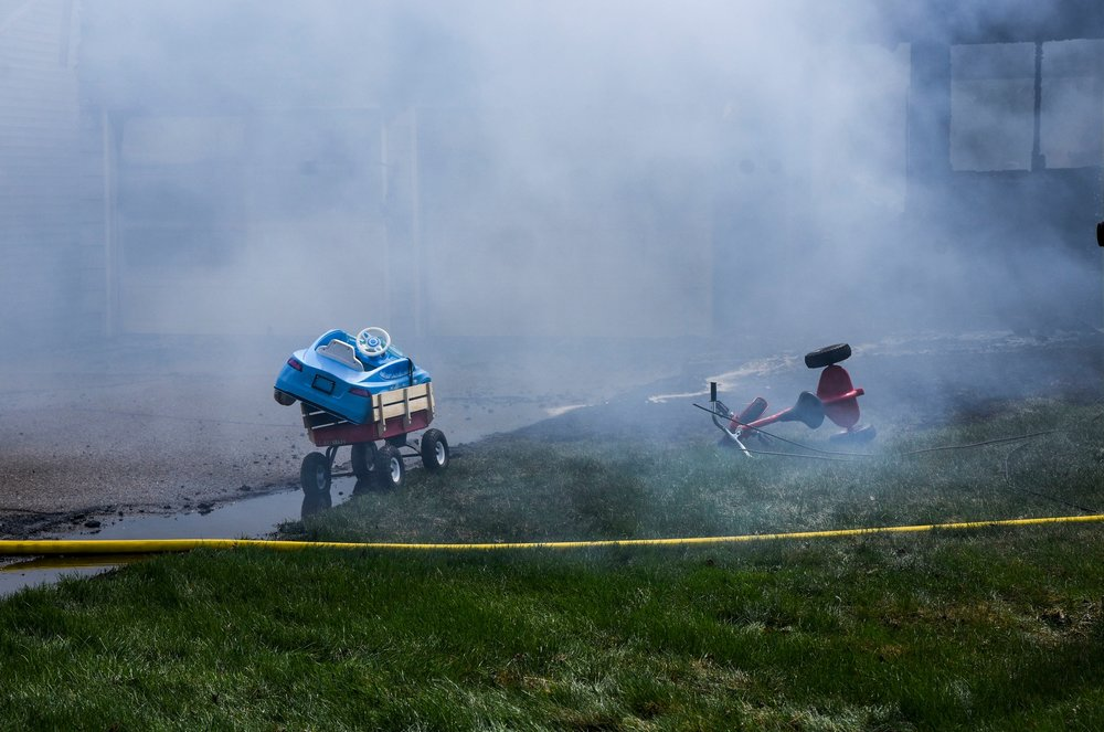 ROSELAND, MN - Children's toys lay outside of the front lawn of a house that was destroyed by a fire May 7.