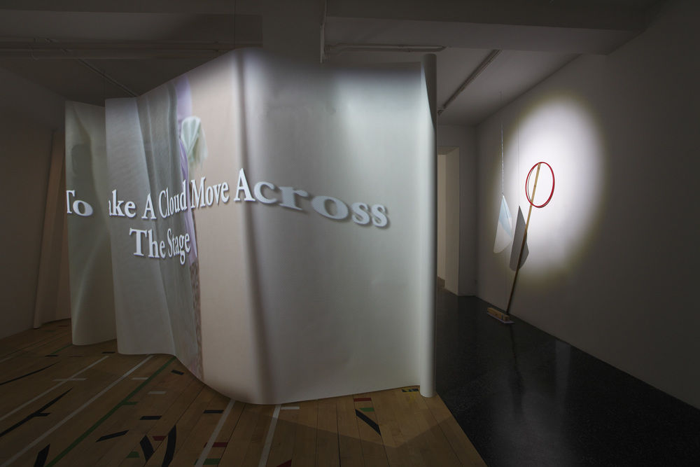 From left to right:  Limbs Describe Curves , 2015, video, and  How To Make Heavens In Sections , 2015, mixed media. Installation Shot: Marta Cervera Gallery, Madrid, Spain (September 2015).