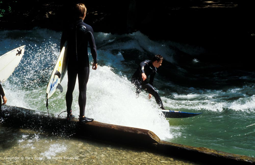 Surfing on the River IEisbach near the English Garden, Munich, Germany.