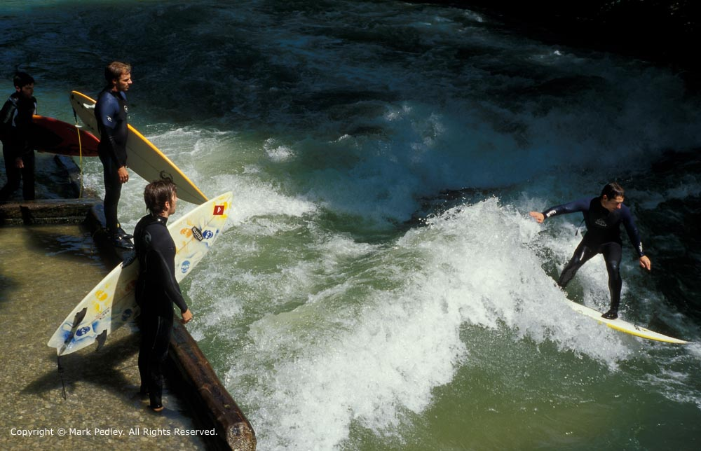 Surfing on the River Eisbach near the English Garden, Munich, Germany.