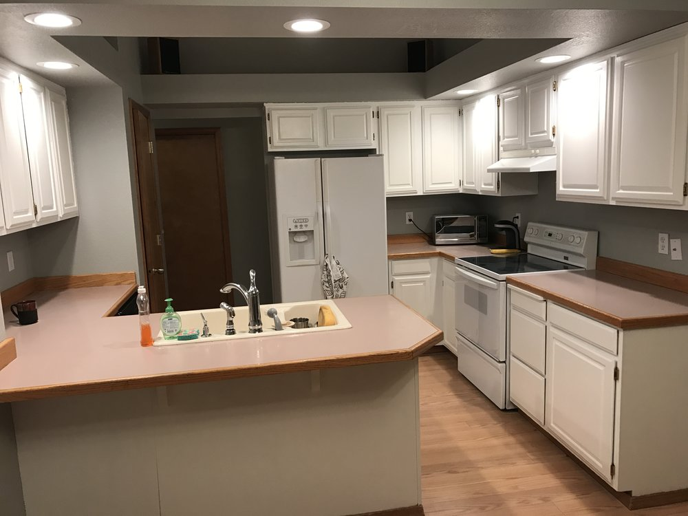 And after! New lighting, white cabinets, modern gray on the walls... we talked about new counter tops...