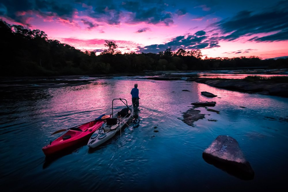 Kent Edmonds drags the kayaks back upstream after a grand day on the Flint River.