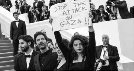 Lebanese actress Manal Issa protesting at the Cannes film festival