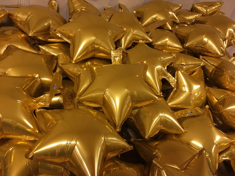 It's not all fun - Spent hours inflating and heat sealing tons of balloons for the gala!