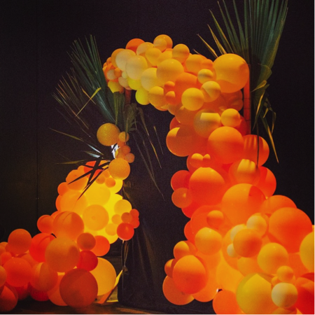 Giant Ferns and Lights accent this Gorgeous Balloon Installation.