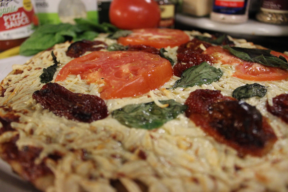 Toppings: sliced red tomato, sun dried tomato, basil