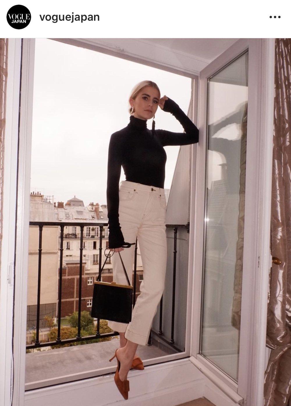 Caro Daur in Vogue Japan wearing Khaite Jeans