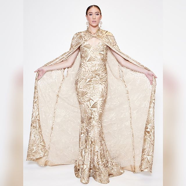 """The """"Priscilla"""" gown and cape is made from beautiful gold patterned stretch sequin. . To make your appointment at the atelier call ☎️(213) 955-5818. . You can also order online at 🖥www.bijanandre.com. . #bijanandreatelier #bijanandre #couture #couturegowns #fashion #style #atelier"""
