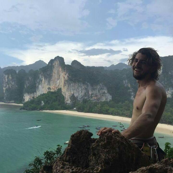 Max on a cliff above Tonsai and Railay beach in Krabi, Thailand.