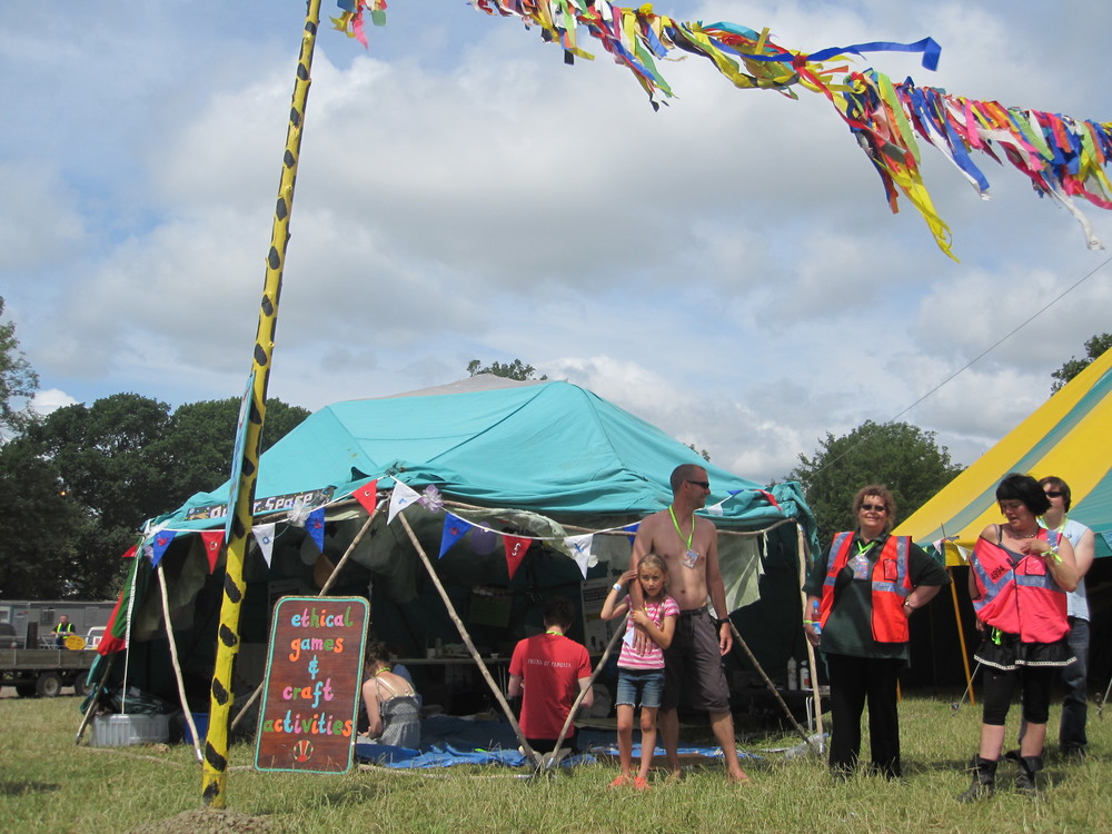 Design and implementation of ethical craft activities at Glastonbury festival using reclaimed materials. Sign writing for Woodcraft Folk tent.