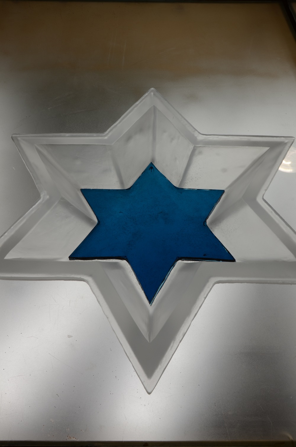 This cast glass Star weighs 25 lbs.