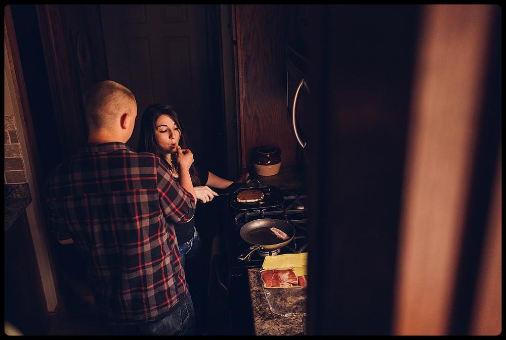 Man feeds fiance breakfast.