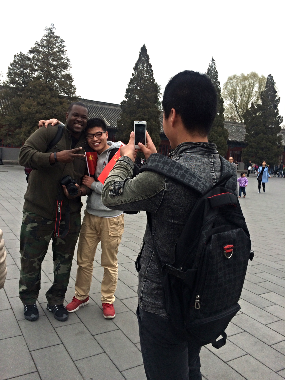 Students taking Antoine's picture at the Forbidden City