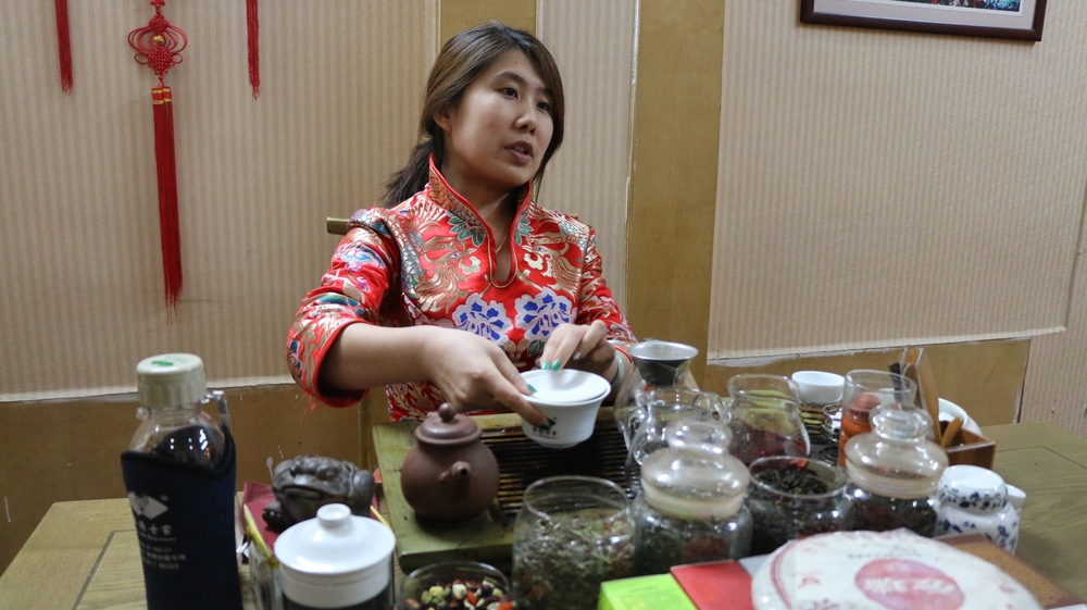Tea garden merchant giving us tastes of the different tea selections.