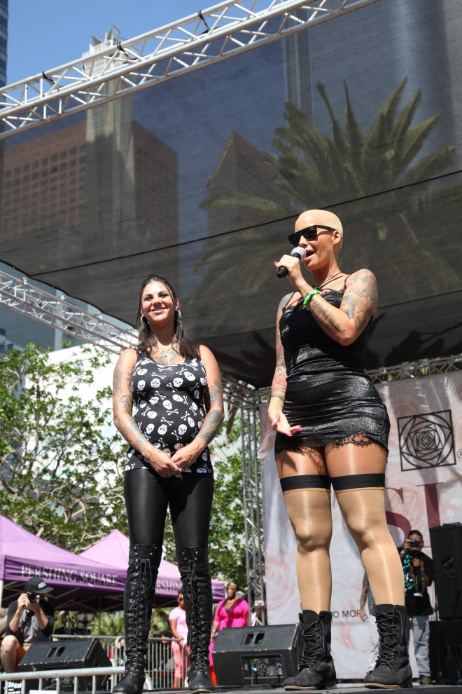 Rose onstage with a pregant Bonnie Rotten