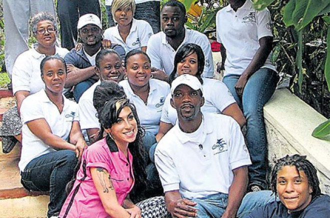 Found on Jamaica Observer.com, Amy is pictured with the staff at Geejam in Port Antonio.