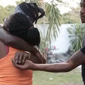 Popcaan in his mothers embrace after arriving home from Antigua.