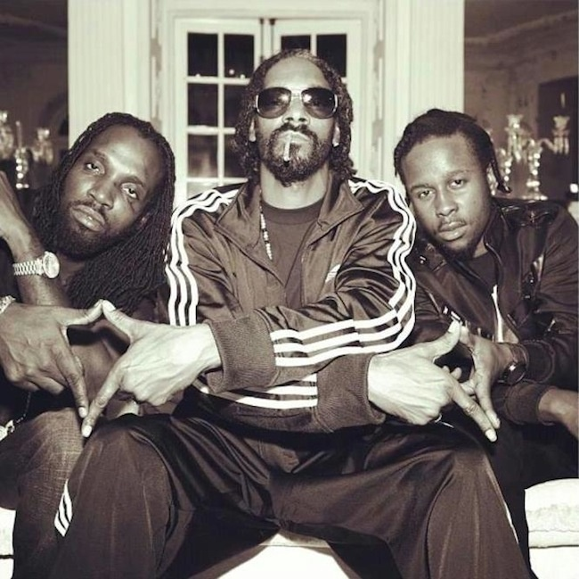 Popcaan and Mavado in happier times pictured with Snoop Dogg (possibly Snoop Lion). Photo source: Noisey
